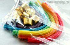 Very cute and easy St. Patrick's Day Candy Rainbows and Pots o Gold gifts made from Twizzlers and Rolos St Pattys, St Patricks Day, Holiday Treats, Holiday Fun, March Crafts, St Paddys Day, Pot Of Gold, Luck Of The Irish, School Parties