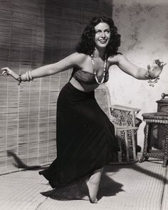 Hedy Lamarr - a remarkable and stunning person! And no gorgeous mask here; smiling for the scene, she's fun and alive, at last...