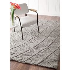 Soft and plush, this cozy Moroccan trellis rug adds warmth and comfort to your living spaces. Inspired by Moroccan Berber carpets, this rug features a bold, lined design that is perfect for casual, modern, urban, and transitional spaces