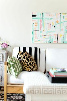 Eclectic & Colorful living room accents | How to Make Your Home Look Expensive on a Budget #theeverygirl
