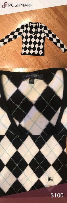 Burberry V-neck sweater Authetic Burberry V-neck argyle sweater. The size is medium and the fabric is 75%  Viscose and 25% Elite. The colors are Black, White, and light blue. Burberry Sweaters V-Necks