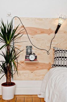 Explore these chic and functional headboard ideas to elevate your bedroom decor. Learn how to create a faux headboard, perfect for small spaces and studio apartments. For more home decorating ideas, head over to domino! Faux Headboard, White Headboard, Shelf Headboard, Plywood Headboard Diy, Diy King Size Headboard, Floating Headboard, Modern Headboard, White Bedding, Homemade Headboards