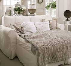 Comfy sofa bed :)Gotta get me one of these for my movie wine nights!