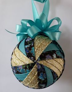 Sewing Fabric Flowers Flower Spinner with Aqua and Gold Quilted Ornament - Purple and aqua flowers spun with hold and aqua accent. Folded Fabric Ornaments, Quilted Christmas Ornaments, Christmas Sewing, Christmas Fabric, Handmade Ornaments, Diy Christmas Ornaments, Christmas Decorations, Ball Ornaments, Ornament Tutorial