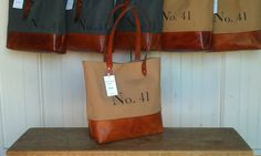 vintage leather bottomed canvas carryall found at TanyaErnst on Etsy.