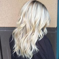 Bright blonde balayage with root shadow