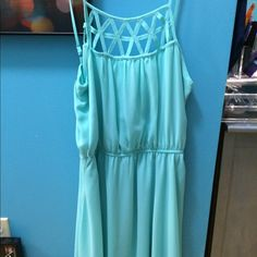 Tiffany Blue Party Dress Worn once for a concert. Tiffany blue color, perfect for any skin tone! Size M, I wear a size 6/8 so if you're that size it's perfect. Breathable fabric, straps are adjustable. The price is negotiable. Comment if you have any questions :) Sequin Hearts Dresses Midi