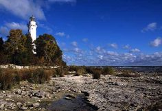 The Cana Island Lighthouse is Door County's most recognizable lighthouse. Located in Baileys Harbor, Wisconsin this lighthouse is one of the most accessible lighthouses in the Door Peninsula.
