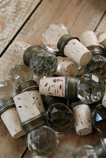 Vintage knobs attached to wine corks - this is such a great look.
