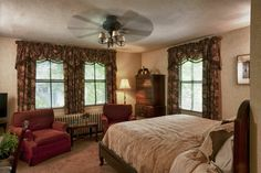 King size bed. two comfortable club chairs and HDTV with DVD player make this a great room.