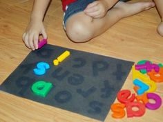 Lay letters on paper in the sun to create a matching game.