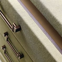Chest of drawer upholstered in linen. Detail showing amazing craftmanship from Promemoria