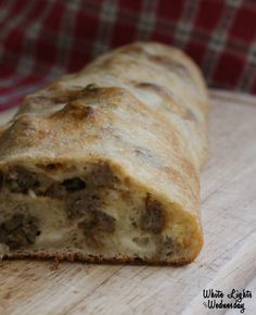 5 Star...Sausage Bread.  Made exactly as written.  It came out almost like a sausage cake.  Rich and moist. Served with Cioppino.  Would be equally good with breakfast.  I can't keep this on the table!  Gets eaten before it leaves the kitchen!! Wonderful!