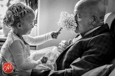 Generations: This snap by Indra Simons sees a little girl sharing the smell of her bouquet with one of the attendees Family Photography, Wedding Photography, Photojournalism, Wedding Photos, Awards, Around The Worlds, Pretty, Pictures, Ol