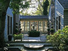 Metal roof covered walkway via Powell Brower. To attach cottage to house but without windows? Outdoor Rooms, Outdoor Living, Casas California, Plan Garage, Garage Roof, Garage Art, Covered Walkway, Covered Garden, Patio Interior