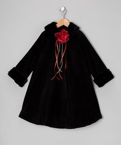 Fleecy soft and featuring faux fur trim, this sweet coat adds an elegant layer of warmth to any formal ensemble. Plus, the pretty rose pin can be easily plucked from this piece for washing.