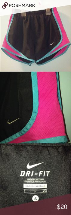 Nike Dri Fit Shorts I'm selling Nike Dri Fit shorts. It's black with a pop of pink and blue. It's very comfortable and breathable material. Great for working out and running. Great condition, barely worn! Size- S Nike Shorts