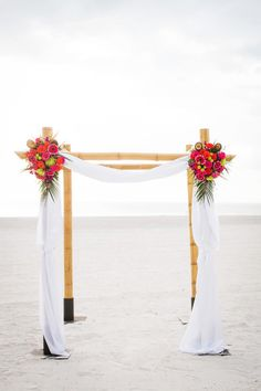 Bamboo Ceremony Arch - Vibrant Beach Wedding at Sirata Beach Resort - Photo by Limelight Photography - click pin for more - www.orangeblossombride.com