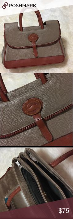Vintage Dooney & Bourke bag Great condition like new but missing the piece that clip the flap on but it works without it and the shoulder strap. Other wise it's in great shape . No tags inside but it's authentic. All weather leather . Tan color with brown details . Medium size . 3 main big compartments. One small inside with a zipper closure and one on the back of the outside. Dooney & Bourke Bags