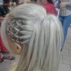 Unique hairstyle.  For more hairstyles, go to - http://sussle.org/t/Hairstyle