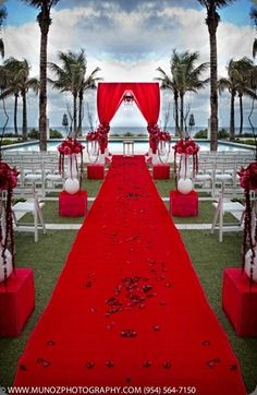 Red WOW! A bride dressed in a white wedding gown would really be the center of attention with this red wedding decor.