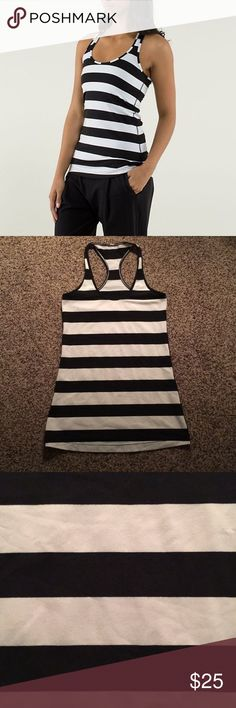 🆕 Lululemon striped Cool Racerback tank Lululemon black and white striped Cool Racerback tank top. Tag has been cut out but it is a size 6. ❗️Sorry, I do not trade.❗️ lululemon athletica Tops Tank Tops