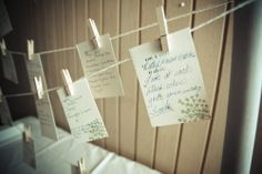 Hanging advice cards to pin on a line above the card/ guestbook table. Different color print to match the colors of the wedding