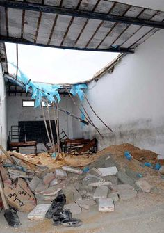 A view of destroyed portion of a classroom roof at a private school after roof collapse incident in Kotri on Tuesday, April 17, 2012.