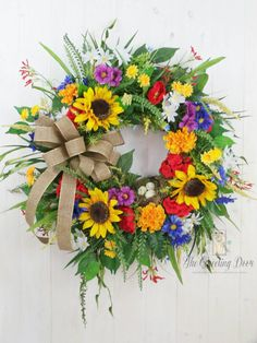 Check out this item in my Etsy shop https://www.etsy.com/listing/272590354/sunflower-wreath-summer-wreath-summer