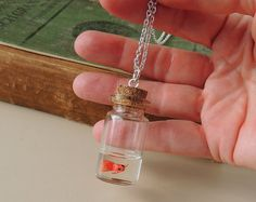 Hey, I found this really awesome Etsy listing at https://www.etsy.com/listing/102032426/goldfish-bottle-necklace-miniature-fish
