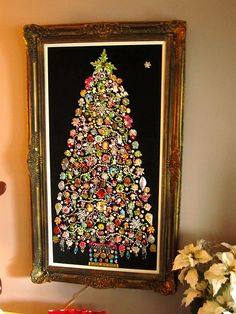 I've been doing these for years - 'jewelry Christmas trees' Two or three years ago I started lining the inside of the shadowbox frames with tiny lights - really makes everything sparkle! Cord hangs down from the back of the frame to plug in. Great fun to make! Need to grab the jewels at the thrift store for this one.