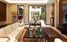 Marvelous Oriental Interior Design Ideas With Modern Sofa Slim Coffee Table Brown Leather Ottoman Plasma Tv  http://www.urbanhomez.com/decors/living_area  http://www.urbanhomez.com/suppliers/interior_designer/chennai? http://www.urbanhomez.com/suppliers/architects/bangalore http://www.urbanhomez.com/suppliers/modular_kitchen,_fittings_and_accessories/chennai http://www.urbanhomez.com/suppliers/modular_kitchen,_fittings_and_accessories/bangalore http://www.urbanhomez.com/