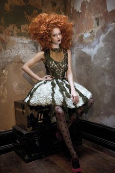 The Autumn/Winter 2011 campaign theme was influenced by Lewis Carroll who wrote Alice's Adventures in Wonderland and took place in a rundown Victorian-style home. The house was filled with quirky decorations which evoked a 1920's vibe. Model Tiah Eckdardt was made up to look like an interpretation of Alice in Wonderland with her curly red hair tousled up into a messy mane.