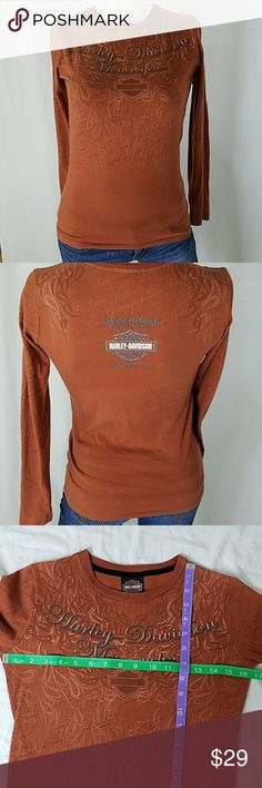 Harley Davidson long sleeve t-shirt Harley Davidson long sleeve orange t-shirt with frame design flames and orange rhinestone. Size small from Shenandoah HD Straton Vs. If you have any questions feel free to ask I will be happy to answer. Harley-Davidson Tops Tees - Long Sleeve