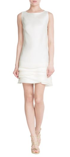 In shimmering white silk, this shift silhouette from Ralph Lauren Black Label is a made chic and feminine with a tiered design in the skirt. Effortless but elegant, we like it best with minimal accessories and barely-there sandals #Stylebop