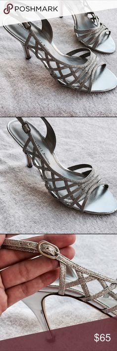 Adrianna Papell Silver Heels Adrianna Papell silver heels sparkle and shine! Ankle strap with adjustable buckle closure. Open toed with leather lining and insole. Rubber outsole. Imported. Worn once. Adrianna Papell Shoes Heels