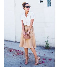 Breezy and easy silhouette with a A-line full skirt and short-sleeve blouse in white and beige.