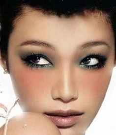 Here, lip and cheek makeup enhances eyes.