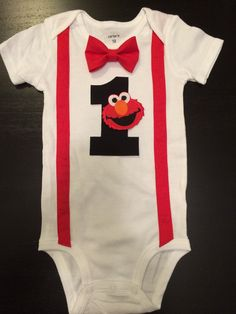 This is the perfect outfit for an Elmo / Sesame Street themed party or photo shoot. I also have this same style onesie available with Cookie Monster. Onesie is Carters brand and available in short or long sleeves. Lots of fabric choices for suspenders and bow tie. Bow tie snaps on/off the onesie making the onesie machine washable. ***NEW**** My bow ties are now attached to the onesie with 2 snaps so they always stay in place....no matter how active your little man is!  Other Availa...