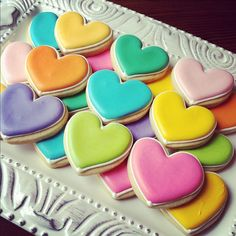 Valentine's Day decorated heart sugar cookies. Royal icing. PInk, purple, green, yellow, turquoise, orange.
