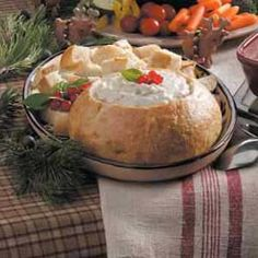 Clam Fondue in a Bread Bowl Recipe -This savory seafood dip is baked right in the bread bowl and is served hot. I usually buy a sourdough bread bowl, but French tastes really good, too.  —Laurel Leslie, Sonora, California