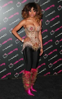 Sequined nipples and furry, hot pink boots.  What's not to like??