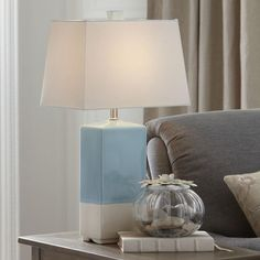 Tabitha Table Lamp   The soothing sky and natural tones of this stunning ceramic lamp lend an inviting air of relaxation and casualness to any space. A linen shade in natural tones completes the look.