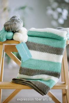 how to knit a baby blanket. I love the aqua, gray and white stripes together.