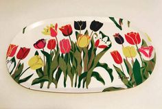 "Rare, original vintage tray designed by Josef Frank, very large serving  tray , made in 1976, signed. With tulips. Beautiful pattern. Mid Century Modern, scandinavian design   STAMPED: Josef Frank, SVENSKT TENN, Stockholm, signed .  Materials: bois contraplaqué   Dimensions: 22"" WIDE X 12.5"" TALL  . Very  good vintage condition, normal signs of age and wear.  The Tulpaner (Tulips) print is distinct without any small softening details. A feature of the print is the petal-thin contours in…"