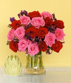MAGENTA Rose & Statice Flowers This sophisticated flower combination of red and pink roses with fillers conveys a deep and extra special feeling of admiration for your special someone. An arrangement that will surely stand out! Fresh Flowers, Spring Flowers, Island Rose, Red And Pink Roses, Flower Arrangements, Vase, Magenta, Deep, Board