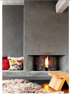 Fireplace if we have wood floors. If cement flooring...warmer fireplace. Add seating on both sides with drawers underneath