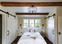 Bedroom. Famrhouse Bedroom. On one side, the barn door conceals the closet and on the other side, the barn door conceals the bathroom. #Bedroom #Barndoor #Farmhouse