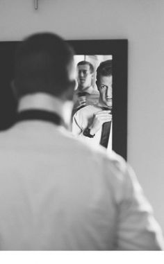 Groom getting ready | Putting on his tie | Photographers: Lad & Lass Photography | Venue: Poortjie Saal |