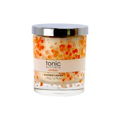 Delicate aromas emanate from this stylish scented candle, providing a welcoming ambiance to any room. Aromatherapy Candles, Scented Candles, Body Lotion, Amber, Fragrance, Delicate, Mugs, Pillows, Tableware
